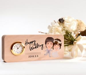 結婚祝いにメッセージ入りの似顔絵置時計